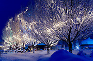 An overnight snowfall is lit by colourful Christmas lights one winter morning at Blackcomb, British Columbia, Canada