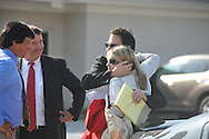 Paul Kevin Curtis (third from l.), who had been in custody under suspicion of sending ricin-laced letters to President Barack Obama and others, talks with (from l.) his brother Jack Curtis, attorney Hal Nielson, and attorney Christi McCoy on Tuesday, April 23, 2013 in Oxford, Miss. The charges were dismissed without prejudice, which means they could be re-instated if prosecutors so choose.
