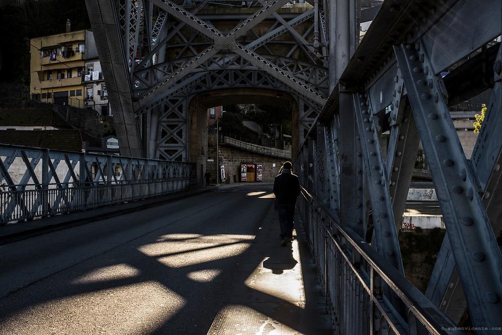 People walking along Dom Luis bridge. Porto, Portugal