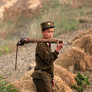 A North Korean soldier walks near the fence that separates China and North Korea on October 19th