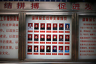 Model workers are shown on a board at the entrance of a factory in the model village of Nan Jie Cun, China, Wednesday, Aug. 26, 2009.  Nan Jie Cun village in central China's Henan province advertises itself as a commune which continues to adhere to the communist teachings of Mao Zedong, who founded the People's Republic 60 years ago. The village's industries are collectively owned. Workers receive bonds, instead of currency, and housing and healthcare are free. They sing revolutionary songs and march to work in lines. Despite being out of step with the rest of today's China, the village's industries are a success, and more than 7,000 migrants have requested to work at Nan Jie Cun.