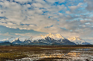 Sunset on the Chugach Mountains along the Copper River Delta near Cordova in Southcentral Alaska. Evening. Spring.
