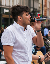 Kings Cross Square, London, July 17th 2015. As part of National Busking Day, Buski in London is launched at King Cross Square with internationally renowned percussion group Stomp and street pop group Tailormade going back to their street performance roots and entertaining the thousands of passing commuters. PICTURED: Tailormade perform in Kings Cross Square.