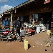 A motorcycle rider along the main street of the village of Kitengeesa in the Central Region of Uganda on 30 July 2014.