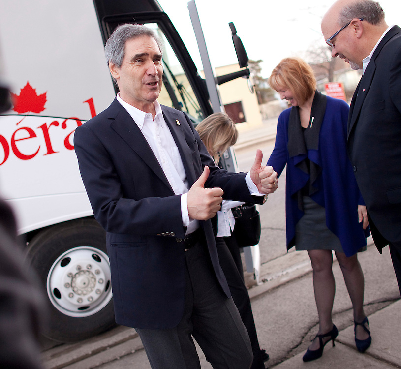 London, ONT.; April 1, 2011--  Liberal leader Michael Ignatieff gives a thumbs up for VON's District Executive Director Catherine Griffith's shoes as he arrives for a round table meeting at their office in London, Ontario, April 1, 2011.<br /> <br /> (GEOFF ROBINS/ Postmedia News)