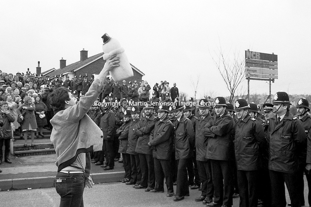A year after the start of the 1984 miners strike at Cortonwood, a picket offers a snowman to Chief Superintendent Nesbitt as a reference to the time he ordered a Range Rover to knock down a snowman picket at Kiveton Park Colliery only to discover it had been built round concrete. 4 March 1985