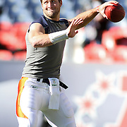 SHOT 1/8/12 1:46:06 PM - The Denver Broncos Tim Tebow warms up by throwing passes to teammates before facing the Pittsburgh Steelers during their AFC Wildcard game at Sports Authority Field at Mile High on Sunday January 8, 2012.  (Photo by Marc Piscotty / © 2012)