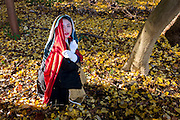 Portrait of a girl doing a CosPlay photo session in the woods at the Meiji Temple, Tokyo.