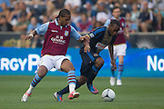 Nathan Delfouneso attacks Amobi Okugo of the Philadelphia Union during a match between Aston Villa FC and Philadelphia Union at PPL Park in Chester, Pennsylvania, USA on Wednesday July 18, 2012. (photo - Mat Boyle)