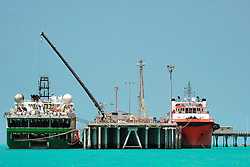 Two oil and gas vessels tied up at Broome Jetty.