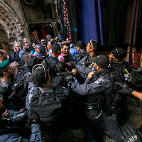 Israeli anti riot police officers prevent a  Palestinian man under the age of 40 years old to enter the Al Aqtsa compound before the Friday pray. <br /> Photo by Olivier Fitoussi
