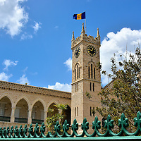 Flag above Clock Tower at Parliament Buildings in Bridgetown, Barbados <br /> The Barbadian flag above The Public Buildings&rsquo; clock tower features a broken trident.  It was adopted on November 30, 1966, the day that Barbados became independent of British rule since English settlers arrived here in 1627. The three points represent the &ldquo;government of, for and by the people.&rdquo;  Today the country is a constitutional monarchy yet Elizabeth II is still considered to be the Queen of Barbados.