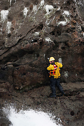 Nick Hancock (yellow) climbs up on Rockall, for his reconnaissance mission for a future 60 day occupation of Rockall. The Rockall Jubilee Expedition, a unique endurance expedition to be undertaken by Nick, in order to raise funds for Help for Heroes .©Michael Schofield..