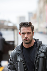 All American man outdoors in a leather jacket