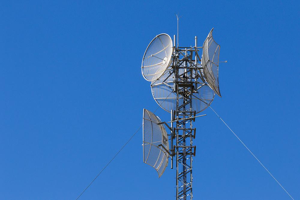 Microwave dish relay  antennas on latitce tower at rural telephone exchange in Goondiwindi, Queensland, Australia
