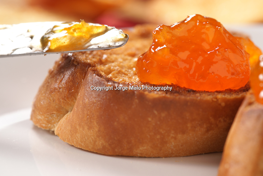 Toast with apricot jam/jelly closeup