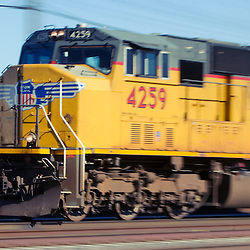 Now the standard locomotive on the Union Pacific, an EMD SD70M speeds through Grand Island, NE westbound towards North Platte.