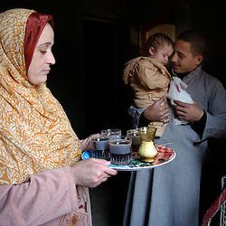 Fayoume, EgyptManal, 27, serves tea to Wael, 16  in the village of Hamidia in Fayoume, Egypt December 7, 2005.  Wael is taking part in a rabbit telefood program funded by FAO..(Photo Ami Vitale)