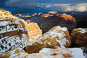 First light of the day warms a winter  scene at the Grand Canyon.