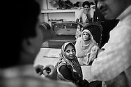 Local doctors together with Unicef staff visit a household resisting vaccination in Patna city..The family are from the conservative Quraish community where routine immunisation runs at less than 10 percent. The community is isolated by its lack of representation and consequent lack of trust in the government. ..India is one of only four countries in the world reported to suffer endemic polio. Only 66 new cases of the disease were reported in India in 2005. But in 2006 that figure leapt ten-fold. In September, UN Secretary General Kofi Annan wrote to Indian Prime Minister Manmohan Singh expressing concern at the new polio outbreak. The Indian government, together with partners including Unicef and Rotary International has embarked on a renewed effort to eradicate polio. Overcrowded areas of poor sanitation are particularly susceptible to the virus. Focusing on the poor north Indian states of Uttar Pradesh and Bihar which between them are home to more than 250 million people, Unicef is coordinating the largest public health drive in the world. The task is to vaccinate all children under the age of five during a series of vaccination rounds. Unicef has mobilised thousands of volunteers to administer and supervise the vaccination effort. Unicef has also recruited people with influence to encourage communities to have their children protected against polio. Misinformation, rumours and a frustration with the lack of other health services mean that many households, particularly in Muslim areas, resist vaccination. . .Photo: Tom Pietrasik.Patna, Bihar, India..November 5th 2006