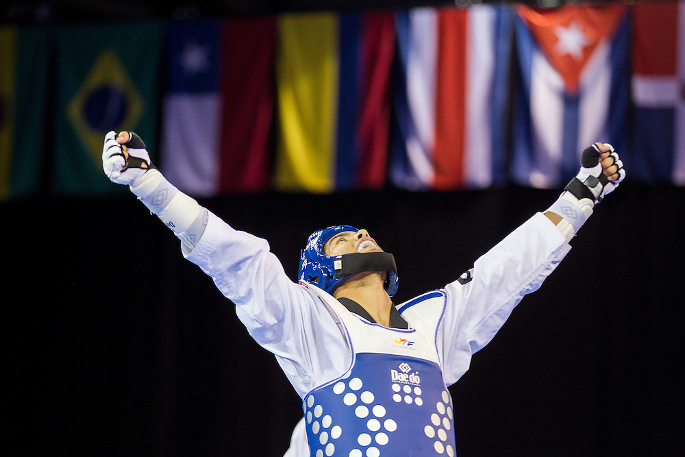 Luis Colon III celebrates his bronze medal win over Henrique Precioso of Brazil in the men's Taekwondo -68kg division of at the 2015 Pan American Games in Toronto, Canada, July 20,  2015.  AFP PHOTO/GEOFF ROBINS
