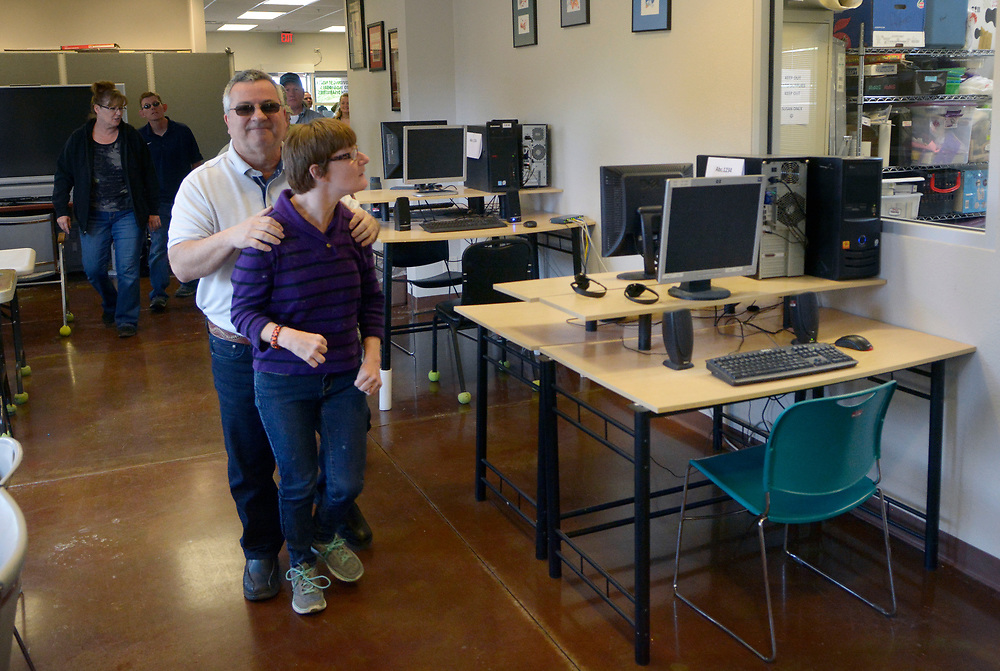 gbs042717b/RIO-WEST --  Ron Epstein of Rio Rancho, walks with his daughter Melinda Epstein in the program area of the expanded new location of LifeROOTS, the not-for-profit organization providing programs and services for children and adults with disabilities, on Thursday, April 27, 2017. Epstein said his daughter has been in the LifeROOTS program since 2004.(Greg Sorber/Albuquerque Journal)