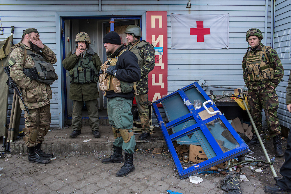 DEBALTSEVE, UKRAINE - FEBRUARY 8, 2015: Medics and soldiers gather at a medical treatment point for Ukrainian fighters in Debaltseve, Ukraine. Fighting between pro-Russia rebels and Ukrainian forces there over the past two weeks has dealt steady casualties to Ukrainian fighters and civilians. CREDIT: Brendan Hoffman for The New York Times