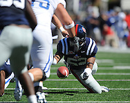 Ole Miss linebacker Mike Marry (52) recovers a fumble at Vaught-Hemingway Stadium in Oxford, Miss. on Saturday, October 2, 2010. Ole Miss won 42-35 to improve to 3-2..