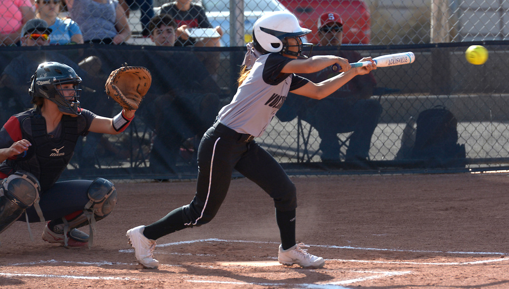 gbs032117m/SPORTS -- Volcano Vista's Alyssa Dilley bunts the ball in the 1st inning during the game against Sandia at Volcano Vista on Tuesday, March 21, 2017. (Greg Sorber/Albuquerque Journal)