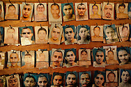 Prisoner photos hang on the wall in Izalco men's prison for incarcerated members of the Mara 18 gang, in El Salvador.