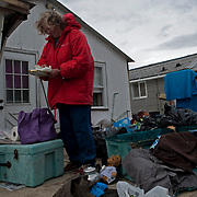 A local goes through her things after the devastation of Hurricane Sandy slowly shows it's destruction. Jonah Markowitz/Falcon Photo Agency