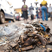 Plantain peelings and other garbage lie uncollected on the thoroughfare into Agbogbloshie, a slum in Ghana's capital, Accra.