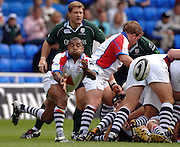 2005/06 Guinness Premiership Rugby, Bristol Scrum half Jacab Rauluni clears the ball from the back of the scrum. London Irish vs Bristol Rugby;  Madejski Stadium, Reading, ENGLAND 24.09.2005   © Peter Spurrier/Intersport Images - email images@intersport-images..