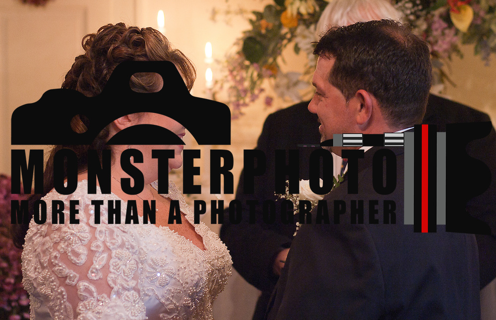 11/11/11 Elkton MD: Susan Lynn McGinnis and Michael Paul Daugherty of New Castle Delaware gaze at each other during their wedding ceremony Friday, Nov. 11, 2011 at Elkton Wedding Chapel in Elkton Maryland.<br /> <br /> Special to The News Journal/SAQUAN STIMPSON