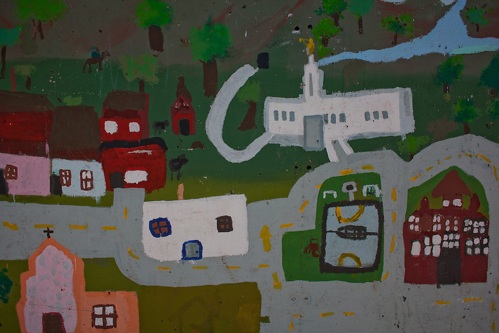 A painting of the town is seen in Colonia Juarez, Mexico in July 2011. United States Presidential candidate Mitt Romney's family migrated to Mexico over 100 years ago after being granted asylum from Mexican President Porfirio Diaz after they had been pursued by the U.S. authorities for polygamy. ..(Romney is currently running for the Republican nomination.)