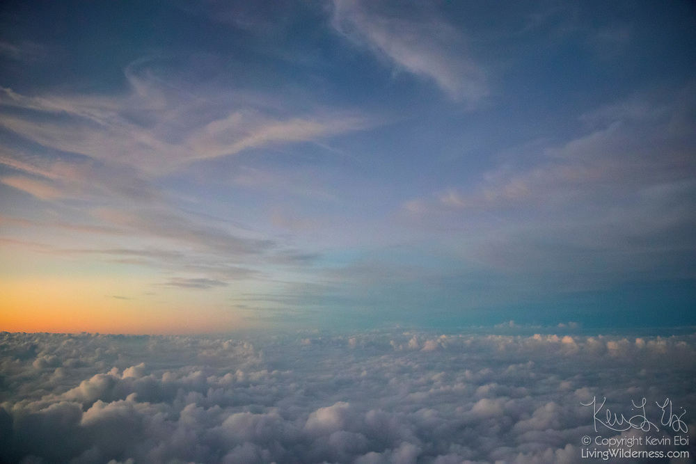 Two layers of clouds — a low layer of stratocumulous clouds and high, whispy cirrus clouds — cover Potomac, Maryland, in this aerial view from approximately 10,000 feet.