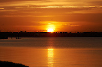 Sunset from Merritt Island, Florida. Image taken with a Nikon D3s and 200-400 mm f/4 VR lens (ISO 800, 200 mm, f/22, 1/320 sec)