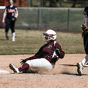 Caravel Academy Outfielder Grace Walker (2) slides safely into second base during a varsity scheduled game between Caravel Academy and The Delmar Wildcats Saturday, April 4, 2015, at Caravel Athletic Field in Bear Delaware.