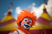 """Jahirt Bermudez, of Colombia, South America, who performs as Perolito the clown for the Cole Bros. Circus, before a show during a stop in Frederick Maryland. The Cole Bros. Circus of the Stars is celebrating its 127th season and bills itself as the """"World's Largest Circus Under The Big Top."""""""