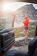 A woman explores the Going to the Sun Road, Glacier National Park, Montana.
