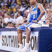 10 April 2008: #3 Allen Iverson of the Denver Nuggets rests on the scoretable during the Denver Nuggets 114-105 victory over the Golden State Warriors at the Oracle Arena in Oakland, CA.