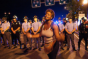 """July 8, 2016: Bri (no last name given) addresses a crowd of demonstrators with a call for justice at the intersection of of Ivan Allen Jr Boulevard and Williams Street. """"We have not seen justice!"""" she said. """"This shit is old, this shit gotta change! We been fighting for this for too long! Something needs to change!"""" She yelled at the crowd and then broke into tears."""