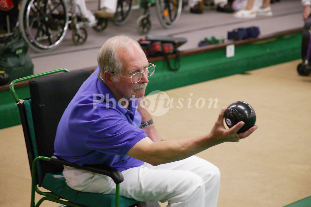 Man with disability taking part in a bowls event held at Solihull Indoor Bowls Centre,