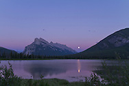 Moonrise 1 day before Full Moon, over Vermilion Lakes in Banff, Alberta. Moon rising between Mt Rundle and Sulphur Mountain. 16-35mm Zoom at 18mm with Canon 7D. Part of a 700-frame time-lapse sequence.