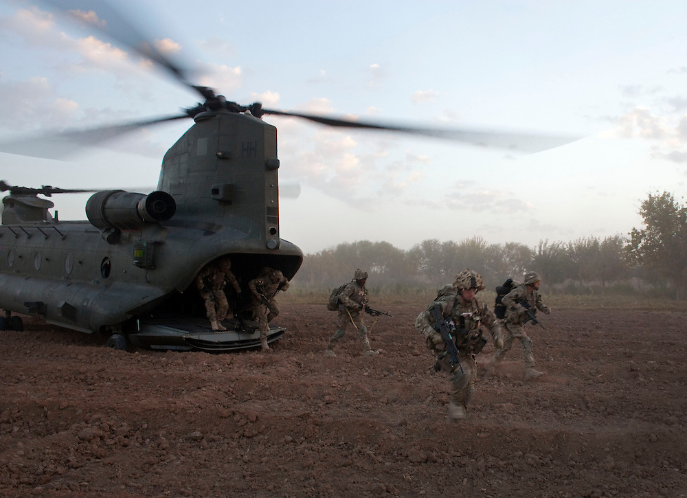 British soldiers from 1 PWRR (Princess of Wales Regiment)  and from the Black Watch deploy from the back of a CH-47 Chinook near to Loya Manda,  as part of Operation Tora Pishaw 5 in Nad e Ali North, Helmand Province, Afghanistan on the 11th of November 2011.