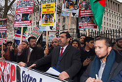 """London, February 10th 2015. Scores of UK Bangladeshis from  Save Bangladesh demonstrate outside Downing Street ahead of handing a letter to David Cameron appealing for him to put pressure on the ruling Awami League to hold free and fair elections and to end """"extra-judicial killings"""" and political violence. PICTURED: Save Bangladesh Coordinator Barrister Abu Baker Molla speaks after delivering his message to No. 10."""