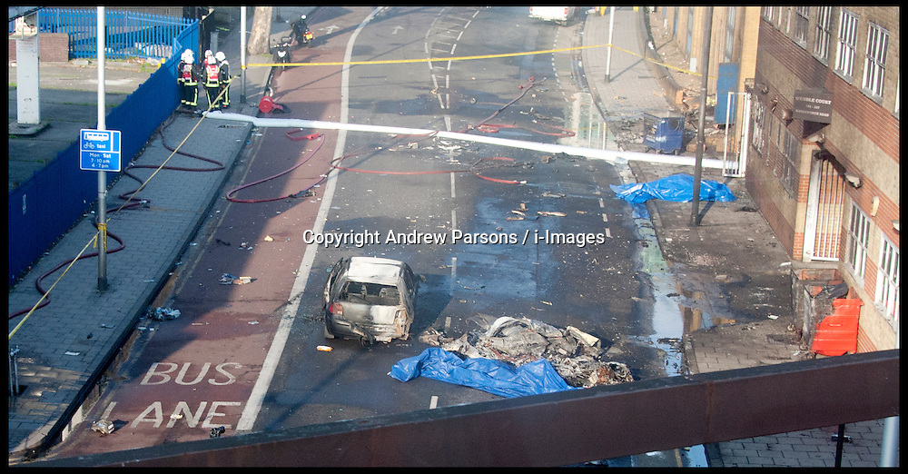 Wreckage at the scene after a helicopter reportedly collided with a crane attached to St Georges Wharf Tower in Vauxhall, on January 16, 2013 in London, England. According to reports, the helicopter hit the crane before plunging into the road below during the morning rush hour, Wednesday January 16, 2013. Photo By Andrew Parsons / i-Images