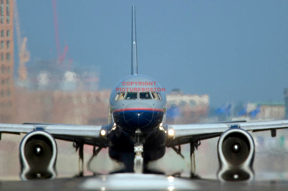 """Various airliners flying in and around Boston's Logan International Airport. Very long lens. NO trickery or photoshop. All photos are """"real time"""" with no trickery or multiple exposure. Here, a Boeing 757 on departure..."""