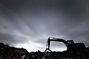 A loading shovel works on heaped wreckage         in Ishinomaki city.