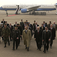 .Ministry of Defense General Tevadze talks with Secretary of Defense Donald H. Rumsfeld and Ambassador Dick Miles after arriving at Tbilisi, Georgia on Dec. 5, 2003. Rumsfeld and acting President Ms. Nino Burdzhanadze, will update reporters on the progress in Georgia.